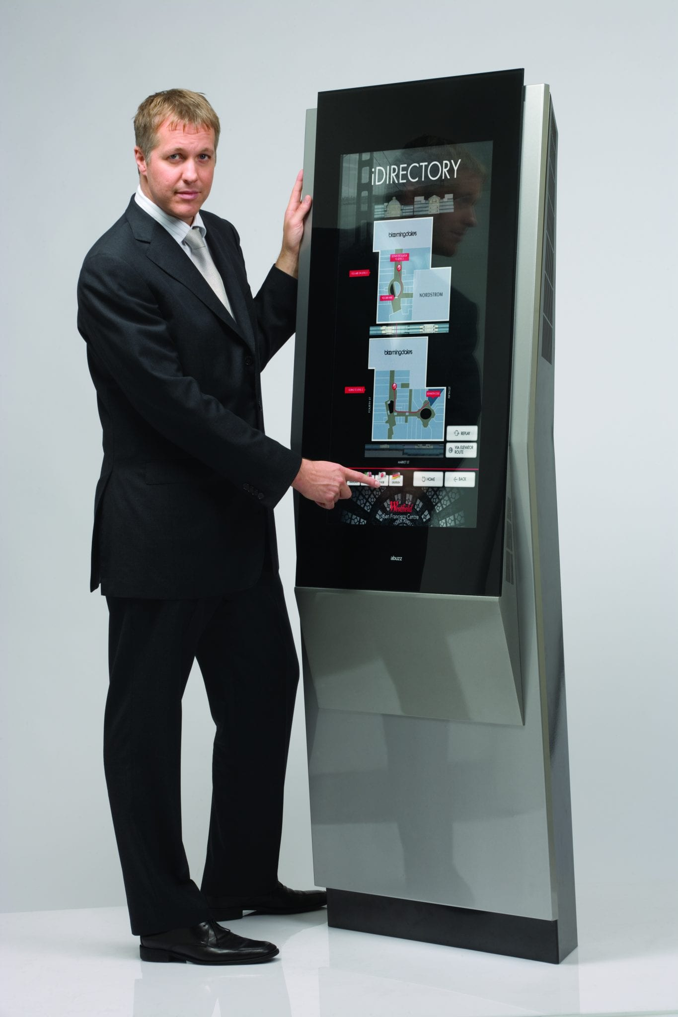 Zytronic employee presenting a large outdoor ZYTOUCH device
