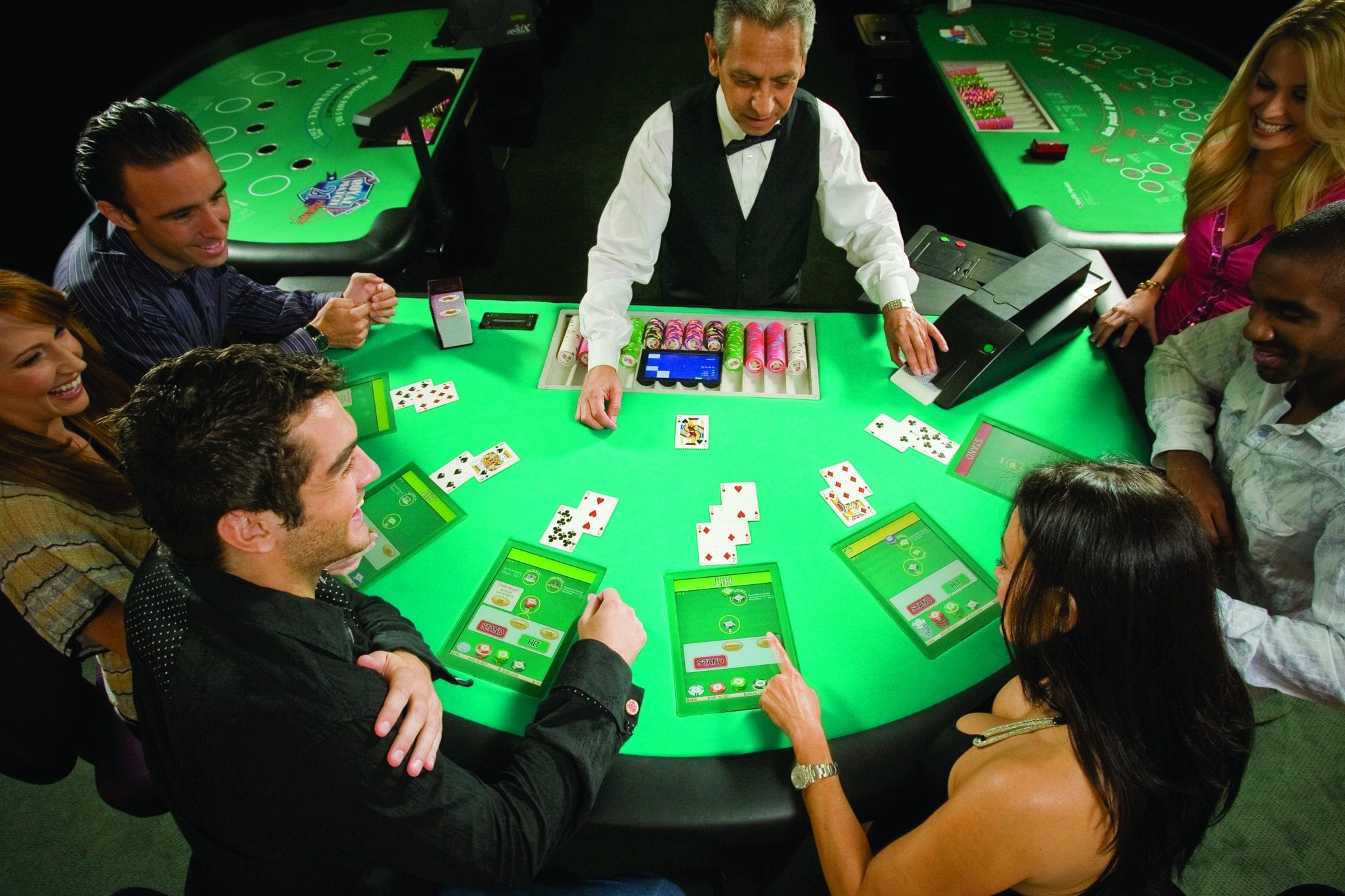 People playing Blackjack at a Zytronic technology interactive casino table